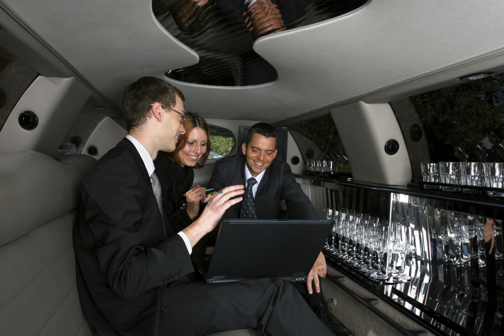 Business meeting in limousine